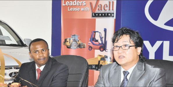 Sam Lee, the regional head of marketing at Hyundai Motors East Africa Corporation (right) addresses the press after he signed a leasing deal with Vehicle and Equipment Leasing Limited chief executive Paul Njeru.